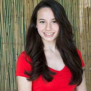 girl with long black hair wearing red shirt